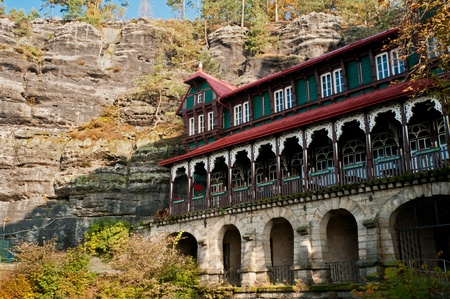 Mountain hotel near Pravcicka brana - the biggest natural gate in Europe. Stock Photo - 11564849