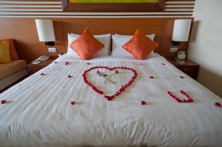 wooden bed: Honeymoon suite in fancy 5 stars hotel.