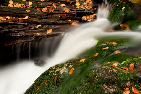 Detailed view of a beautiful waterfall during the autumn time. Stock Photo