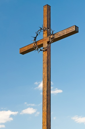 bless: Cross with a crown of thorns on the National Cemetery in Terezin