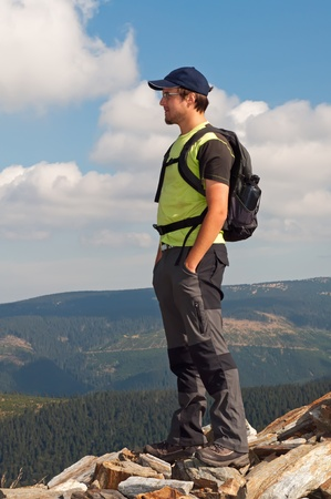trekker: Young tourist on the top of mountain massif.