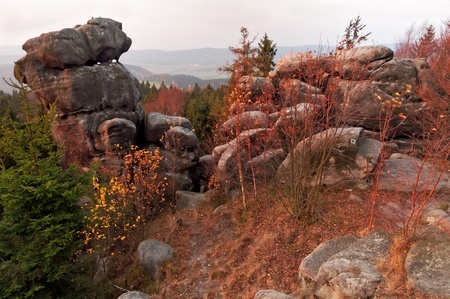Beautiful autumn landscape during the sunrise with rocky town in Adrspach, Czech Republic. photo