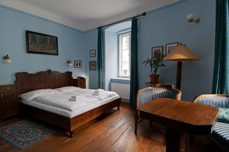 carpet and flooring: View of a rustic hotel room interior in Cesky Krumlov