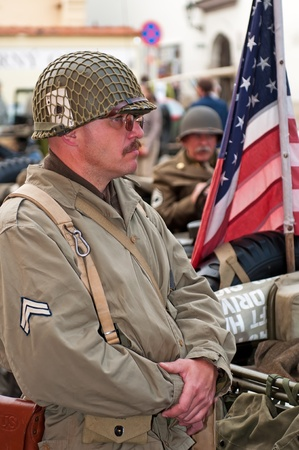 PRAGUE, CZECH REPUBLIC - APRIL 29: Member of Old Car Rangers club wears historical American uniform on April 29, 2011 in Prague, Czech Republic. It is part of reenactment event - the fall of German army in Prague in 1945. Stock Photo - 12060748