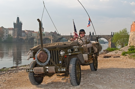 PRAGUE, CZECH REPUBLIC - APRIL 29: Member of Old Car Rangers club wears historic American uniform on April 29, 2011 in Prague, Czech Republic. It is part of reenactment event - the fall of German army in Prague in 1945. Stock Photo - 12060749