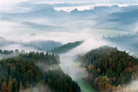 Misty morning in a beautiful mountain of Czech-Saxony Switzerland. photo
