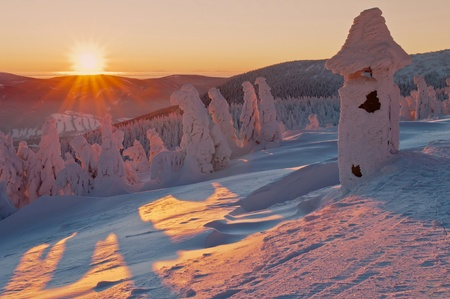 Winter wonderland during the colorful sunrise. photo
