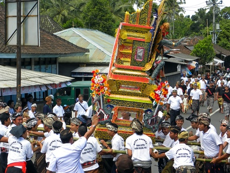 cremation: MENGWI, BALI - JUNE 29: Picture of typical Balinese cremation ceremony with immolations and gifts for the deceased person on June 29, 2009 in Mengwi, Bali. The whole community participates to the event. Editorial