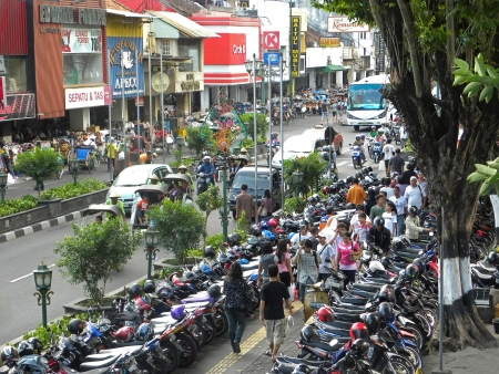 jogjakarta: YOGYAKARTA, INDONESIA - JULY 7: Aerial view of Yogyakarta with its typical hundreds of motorbikes on July 7, 2009 in Yogyakarta, Indonesia. Motorbikes is the easiest and most common way of transportation in Yogyakarta.