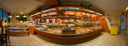 PRAGUE, CZECH REPUBLIC - JUNE 29: Panoramic view of a bakery shop interior on June 29, 2012 in Prague, Czech Republic. It shows a small tradinitional shop of a European style. Stock Photo - 14392481