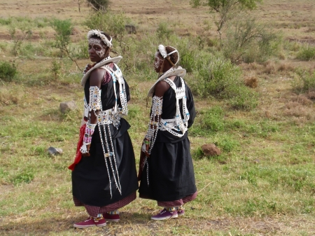maasai: ARUSHA, TANZANIA - JANUARY 6: Picture of Maasai girls in traditional clothing on the road to Arusha on January 6, 2009 in Arusha, Tanzania.  The Maasai are the most well known of all African ethnic groups. Editorial
