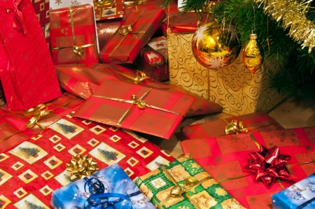 home decorated: Christmas gifts, Cristmas balls and Cristmas tree branch. Stock Photo