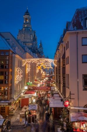 DRESDEN, GERMANY - DECEMBER 7, 2012: An unidentified group of people enjoy Christmas market in Dresden on December 7, 2012. It is Germany
