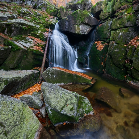 Panoramic view of a beautiful autumn waterfall. photo
