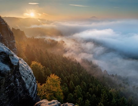 View of a beautiful misty sunrise on the top of the hill, panoramic picture. photo
