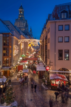 DRESDEN, GERMANY - DECEMBER 7, 2012: An unidentified group of people enjoy Christmas market in Dresden on December 7, 2012. It is Germanys oldest Christmas Market with a very long history dating back to 1434.