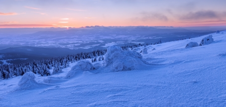 View of winter wonderland during the sunset time, panoramic picture. photo