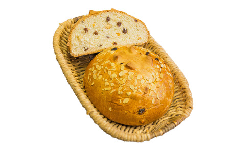 Sweet bread in a basket isolated on a white background. photo