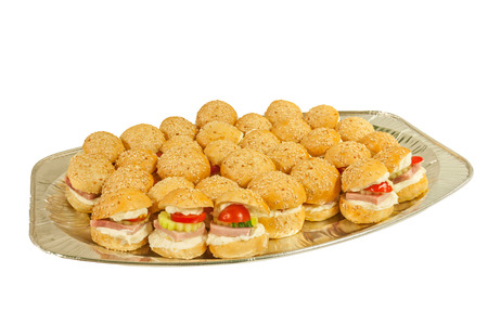 Plate of sandwiches isolated on a white background. photo