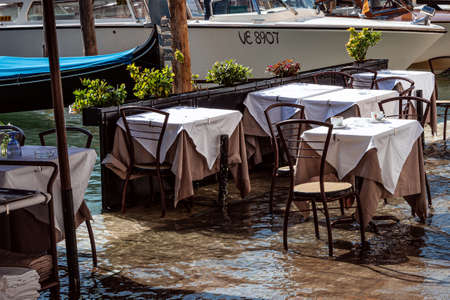 Flooded tables underwater at restaurant in Venice