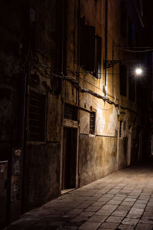 empty street at night in venice illumionated by street light