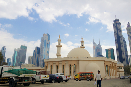 Contrast between old and new Dubai  Traditional mosque with skyscrapers on background