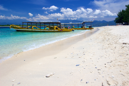 yellow boats: Yellow boats on beach on Gili Trawangan island, Indonesia, white sand on sunny day Stock Photo