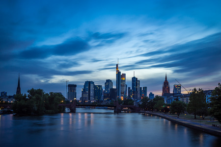 Frankfurt am Main financial and office district (skyline) at sunset viewed from bridge