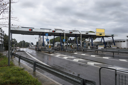 tollway: toll booth with wet road Stock Photo