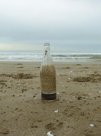 castaway: bottle abandoned on a beach