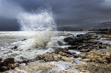 waves crashing: waves crashing on the rocks
