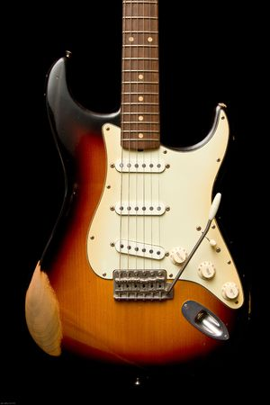 stratocaster: Vintage Stratocaster with a sunburst finish well worn in.