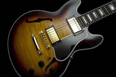Vintage guitar with sunburst finish isolated on black Stock Photo