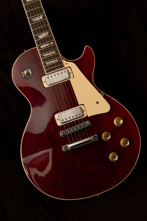 red vintage guitar isolated on black Stock Photo