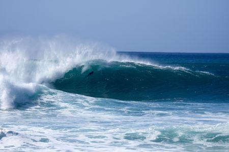 Huge surf at bonzai pipeline on oahu hawaii photo