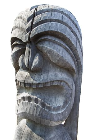 Carved wood tiki idol on white background