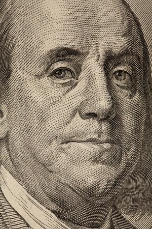 portrait of ben franklin on a 100 dollar bill