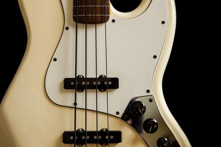 bass guitar: bass guitar crop of vintage style creme color bass