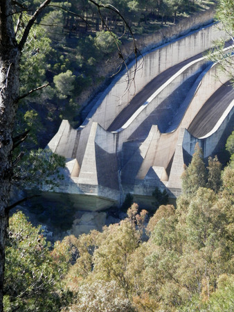 overflow: Sluice overflow in woods at Ardales reservoir near El Chorro, Andalucia Stock Photo