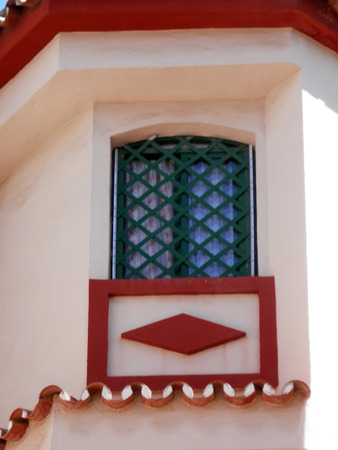 Green trellis window and traditional tiling on house in Fuengirola Andalucia