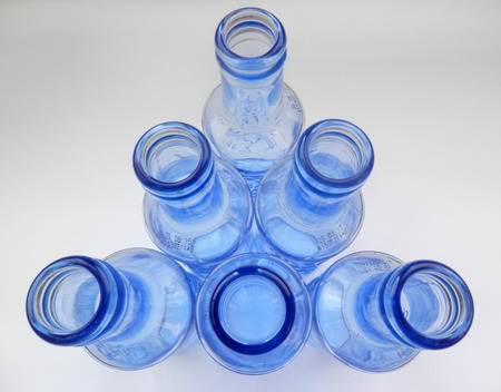 Arrangement of six sturdy blue bottles