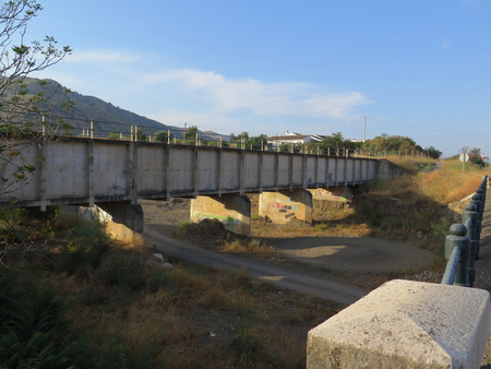 riverbed: Concrete aquaduct irregation bridge across dry riverbed near Alora Andalucia Stock Photo