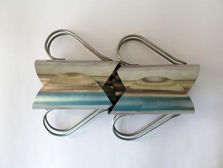 handled: Metal handled glass holders in artistic arrangement Stock Photo