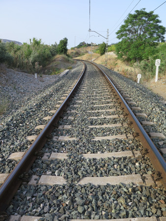 ballast: Curved Railway track in ballast on local line between Alora and Malaga Andalucia Stock Photo