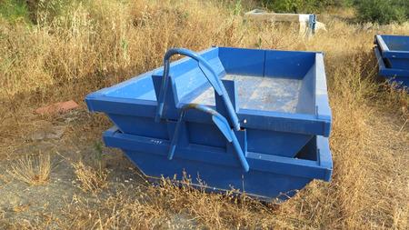 wasteland: Empty blue builders skips on wasteland near Alora Andalucia Stock Photo