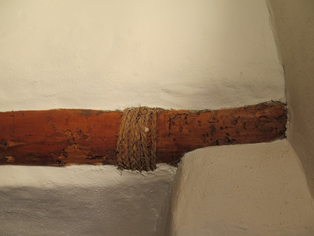 binding: Old worm eaten wooden beam with esparto grass binding in Andalucian house Stock Photo