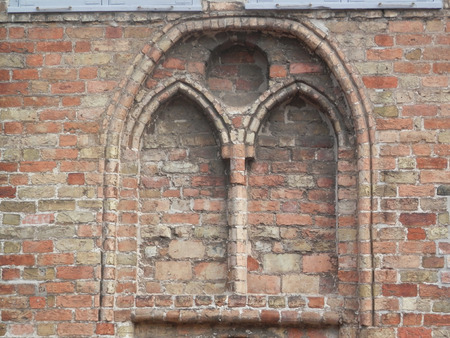 arched: Arched bricked up window in Brick wall in Schleswig, Germany