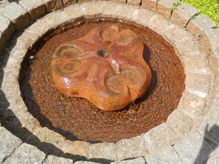 trickle: Round low trickle fountain in Graasten, Denmark Stock Photo