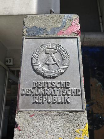 iron curtain: German Democratic Republic Logo at Checkpoint Charlie, Berlin