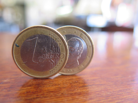 bar top: Two One Euro coins balancing on bar top